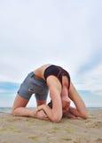 Girl doing yoga on coast Royalty Free Stock Photos