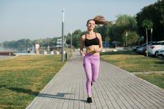 Girl doing yoga fitness exercise. Stock Photos
