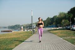 Girl doing yoga fitness exercise. Stock Photo