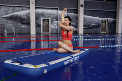 Girl doing yoga on a fitness raft Royalty Free Stock Photos