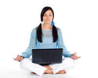 Girl doing yoga with laptop Royalty Free Stock Photo