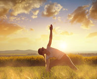 Girl doing yoga on meadow. Girl doing yoga on meadow at sunset Royalty Free Stock Photo
