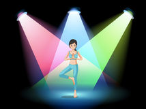A girl doing yoga in the middle of the stage Royalty Free Stock Image