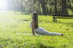 Girl doing yoga Stock Images
