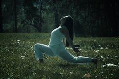 Girl doing yoga Stock Photos