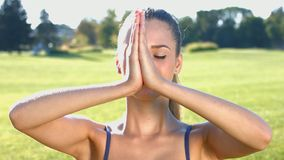 Girl doing yoga on the nature. stock video