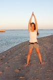 Girl doing yoga near sea Royalty Free Stock Photos