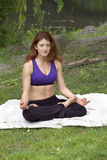 Girl doing yoga in park Stock Photos