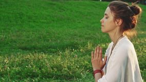Girl is doing yoga in a peaceful atmosphere stock photography