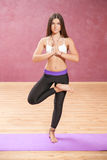 Girl doing yoga posture standing on one leg. With open eyes Royalty Free Stock Image