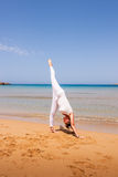 Girl doing yoga. On a sandy beach stock photos