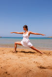 Girl doing yoga. On a sandy beach stock images