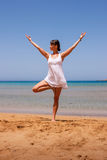Girl doing yoga. On a sandy beach Royalty Free Stock Images