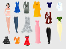 Girl-doll. With a wardrobe of clothes ... a partial Royalty Free Stock Images