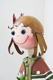 Girl doll. A girl is a doll Stock Photo