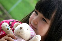 Girl With Doll Royalty Free Stock Image