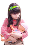 Girl With Doll. Portrait of the small girl with her darling doll Royalty Free Stock Photo