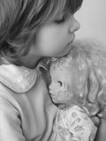 Girl with doll. Small pretty girl with her darling doll Royalty Free Stock Photos