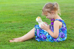 Girl with doll. Stock Photography