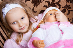 Girl with a Doll Royalty Free Stock Photos