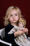 Girl and doll Royalty Free Stock Photography