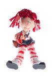 Girl doll. Cute girl doll holding heart, isolated on white Stock Image