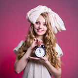 Girl doll with alarm clock Royalty Free Stock Photography
