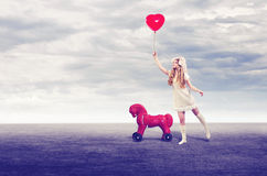 Girl doll with balloon Stock Photography
