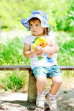 Girl with doll on the bench Stock Photo