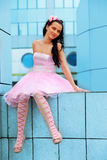 Girl doll in Big City Stock Photo