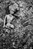 Girl Doll Blow Apart And Lying In Pile Of Ash Royalty Free Stock Photo