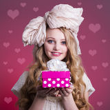 Girl doll with gift box Royalty Free Stock Images