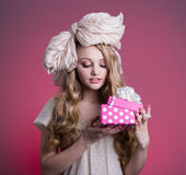 Girl doll with gift box Stock Photos