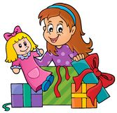 Girl with doll and gifts theme 1 Royalty Free Stock Photography