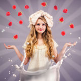 Girl doll juggling ripe berries Stock Photography