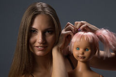 Girl with doll Royalty Free Stock Photos