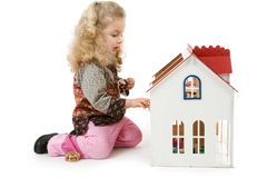 Girl with doll´s house Stock Photo