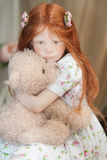 Girl doll with teddy bear Stock Image
