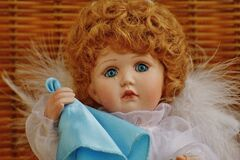 Girl Doll in White Fur Dress Holding Blue Handkerchief Stock Images