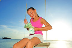 Girl with Dollars Royalty Free Stock Photography