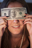 Girl and dollars Royalty Free Stock Photo