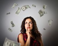 Girl and DOLLARS. Girl and falling dollar banknotes. Currency and lottery concept. Young woman is doing something Stock Photos