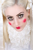 Girl with dolly makeup Stock Images