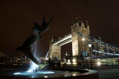 Girl with a Dolphin fountain and Tower Bridge, UK Royalty Free Stock Image
