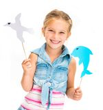 Girl with dolphin and gull Stock Images