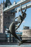 Girl, Dolphin and Tower Bridge Royalty Free Stock Photo