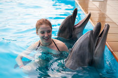 Girl and the dolphins Royalty Free Stock Image