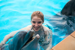 Girl and the dolphins Royalty Free Stock Photos