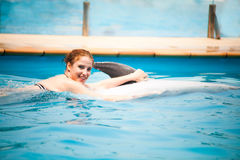 Girl and the dolphins Royalty Free Stock Images
