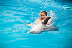 Girl and the dolphins Royalty Free Stock Photography